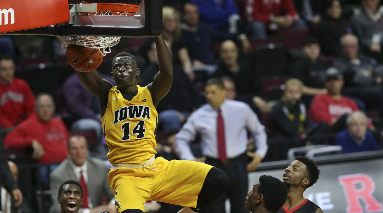 Iowa guard Peter Jok (14) dunks a basket during the first half of an NCAA college basketball game against Rutgers, Thursday, Jan. 21, 2016, in Piscataway, N.J. (AP Photo/Mel Evans)
