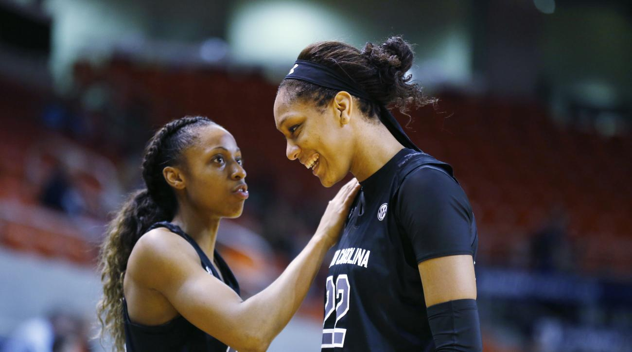 South Carolina guard Tiffany Mitchell, left, pats South Carolina forward A'ja Wilson, right, on the shoulder after pulling a head of Auburn during the second half of an NCAA college basketball game, Thursday, Jan. 21, 2016, in Auburn, Ala. South Carolina