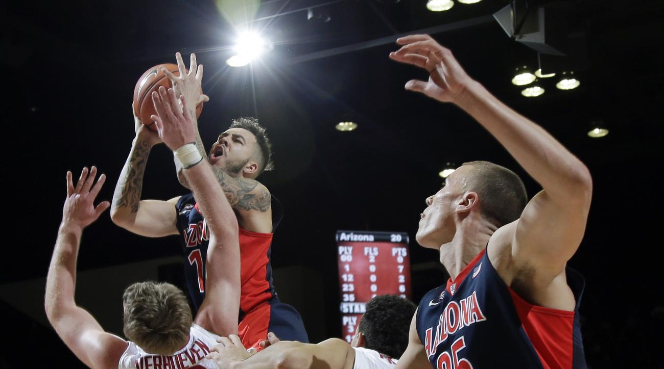 Arizona guard Gabe York (1) drives to the basket over Stanford center Grant Verhoeven (30) during the first half of an NCAA college basketball game Thursday, Jan. 21, 2016, in Stanford, Calif. (AP Photo/Marcio Jose Sanchez)