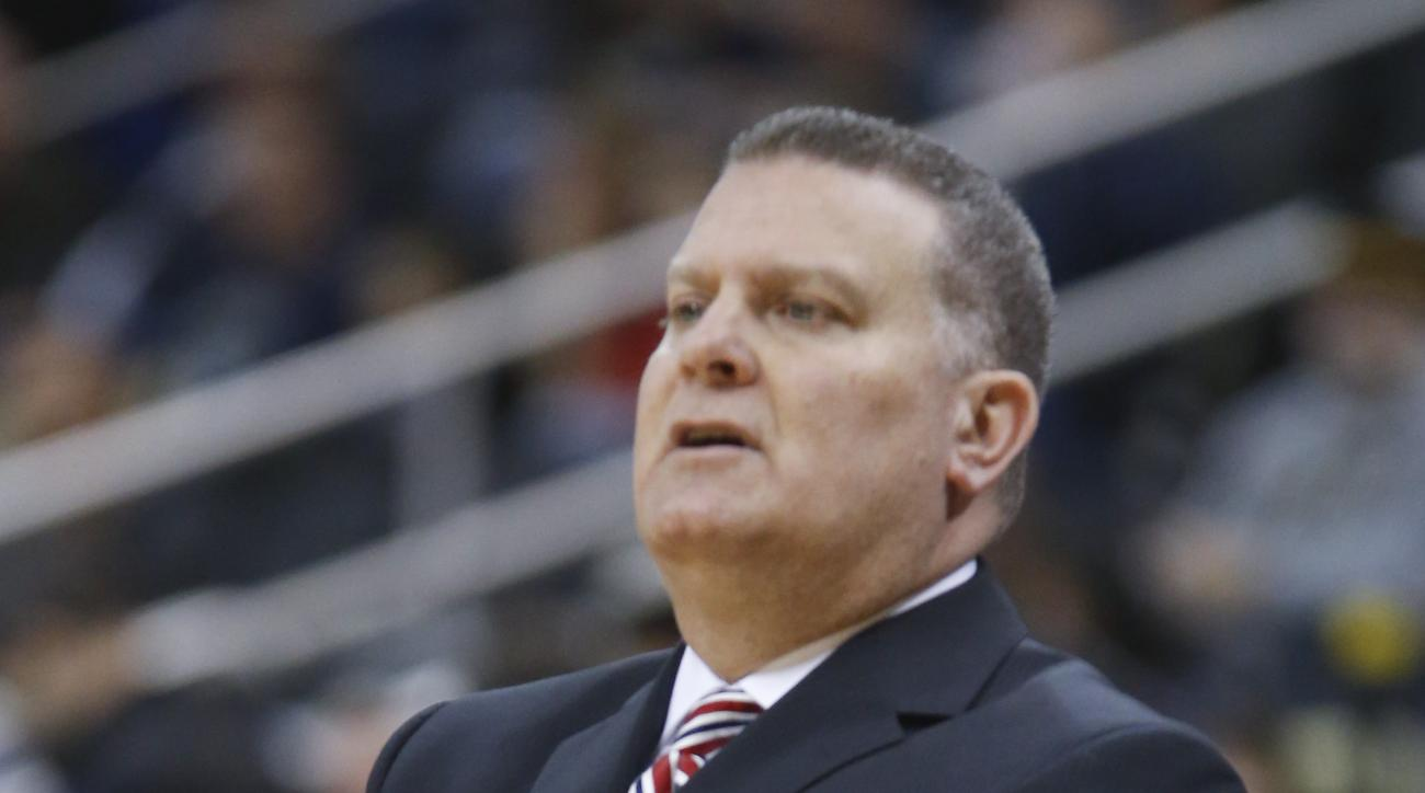Duquesne head coach Jim Ferry works with his team during an NCAA college basketball game against Pittsburgh, Friday, Dec. 4, 2015, in Pittsburgh. (AP Photo/Keith Srakocic)