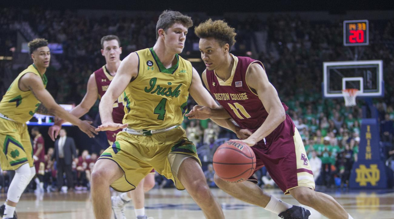 Boston College's A.J.Turner (11) drives by Notre Dame's Matt Ryan (4) during the first half of an NCAA college basketball game Saturday, Jan. 23, 2016, in South Bend, Ind.  (AP Photo/Robert Franklin)