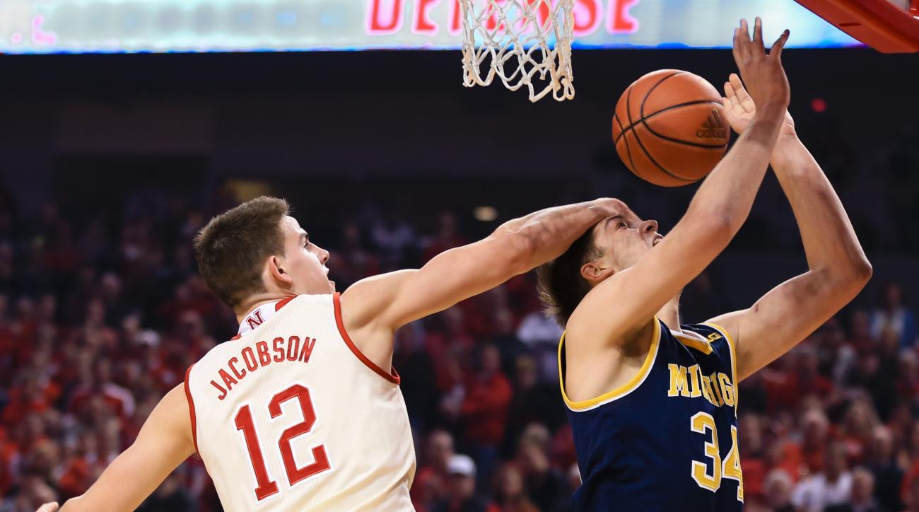 Nebraska's Michael Jacobson (12) fouls Michigan's Mark Donnal (34) during the first half of an NCAA college basketball game in Lincoln, Neb., Saturday, Jan. 23, 2016. (AP Photo/Nati Harnik)