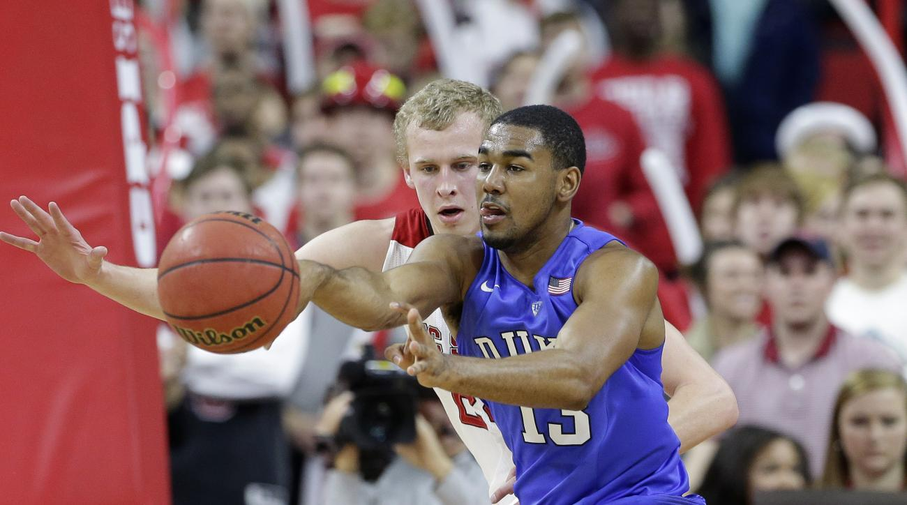 Duke's Matt Jones (13) passes as North Carolina State's Maverick Rowan defends during the first half of an NCAA college basketball game in Raleigh, N.C., Saturday, Jan. 23, 2016. (AP Photo/Gerry Broome)