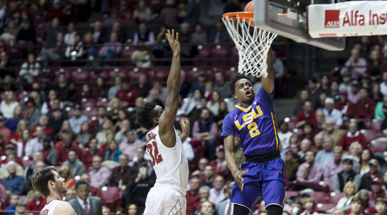 LSU guard Antonio Blakeney scores two past Alabama guard Retin Obasohan (32) during an NCAA college basketball game, Saturday, Jan. 23, 2016, at Coleman Coliseum in Tuscaloosa, Ala. (Vasha Hunt/AL.com via AP) MAGS OUT; MANDATORY CREDIT