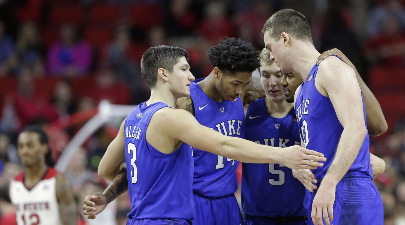 Duke's Grayson Allen (3), Brandon Ingram (14), Luke Kennard (5), Matt Jones and Marshall Plumlee come together following a play during the second half of an NCAA college basketball game against against North Carolina State in Raleigh, N.C., Saturday, Jan.