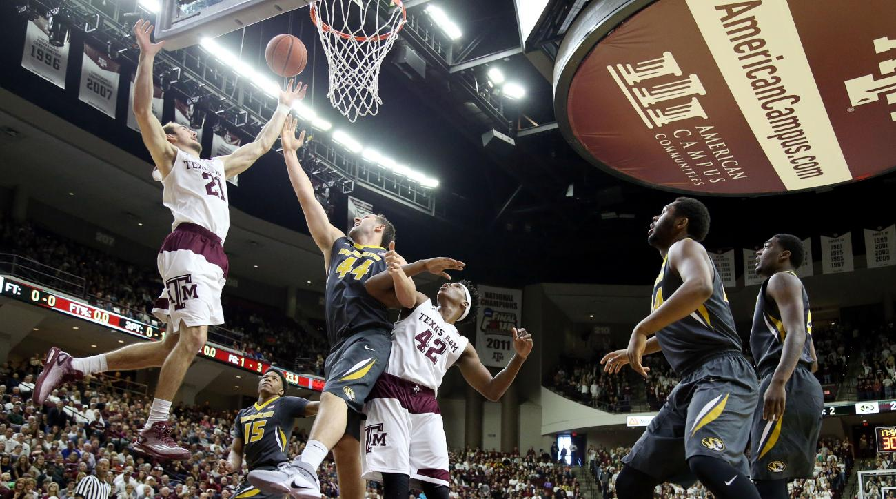 Texas A&M's Alex Caruso (21) goes after a rebound against Missouri's Ryan Rosburg (44) and Texas A&M's Tavario Miller (42) during the first half of an NCAA college basketball game, Saturday, Jan. 23, 2016, in College Station, Texas.  (AP Photo/Sam Craft)