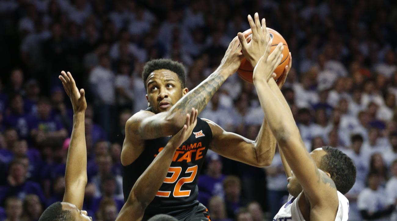 Oklahoma State guard Jeff Newberry (22) drives for the basket against Kansas State during an NCAA college basketball game Saturday, Jan. 23, 2016, in Manhattan, Kan. (Bo Rader /The Wichita Eagle via AP) LOCAL TELEVISION OUT; MAGS OUT; LOCAL RADIO OUT; LOC