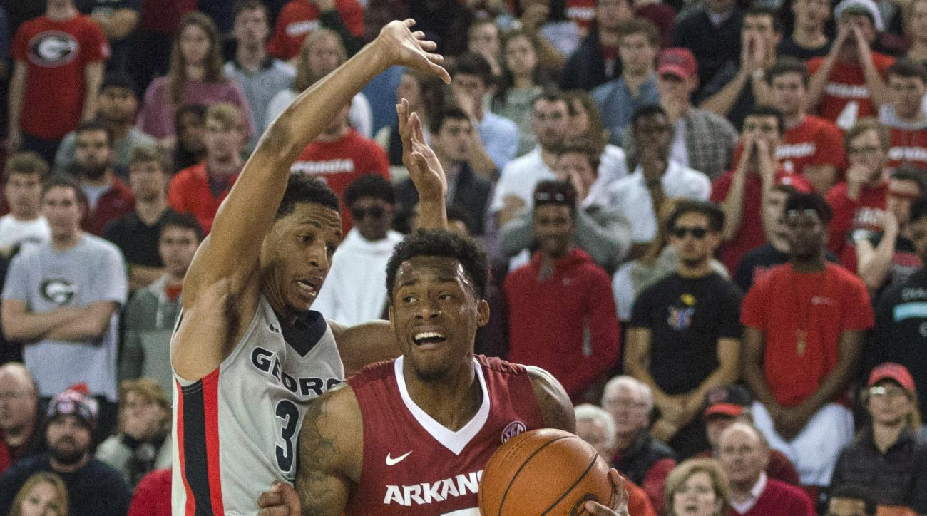 Arkansas guard Anthlon Bell (5) drives past Georgia guard J.J. Frazier (30) during an NCAA college basketball game Saturday, Jan. 23, 2016, in Athens, Ga. (Taylor Craig Sutton/Athens Banner-Herald via AP)
