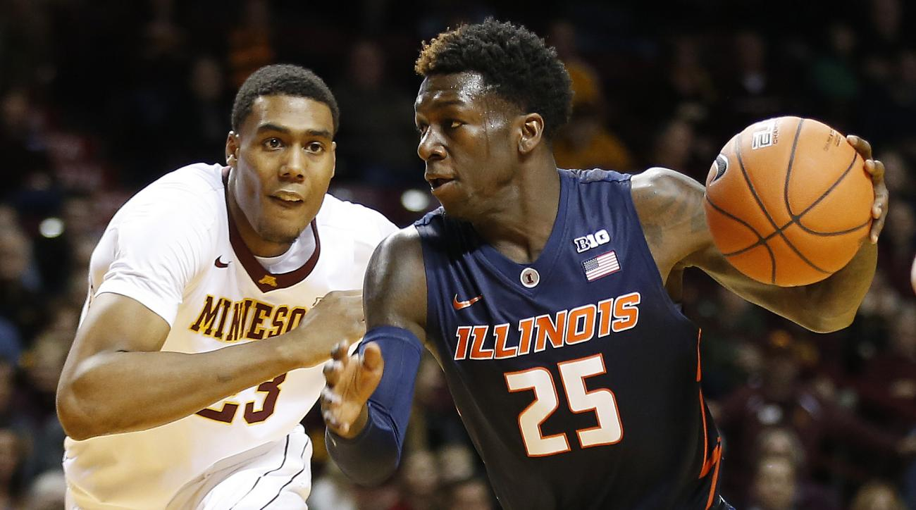 Illinois guard Kendrick Nunn (25) drives the ball around Minnesota forward Charles Buggs (23) in the first half of an NCAA college basketball game Saturday, Jan. 23, 2016 in Minneapolis. (AP Photo/Stacy Bengs)
