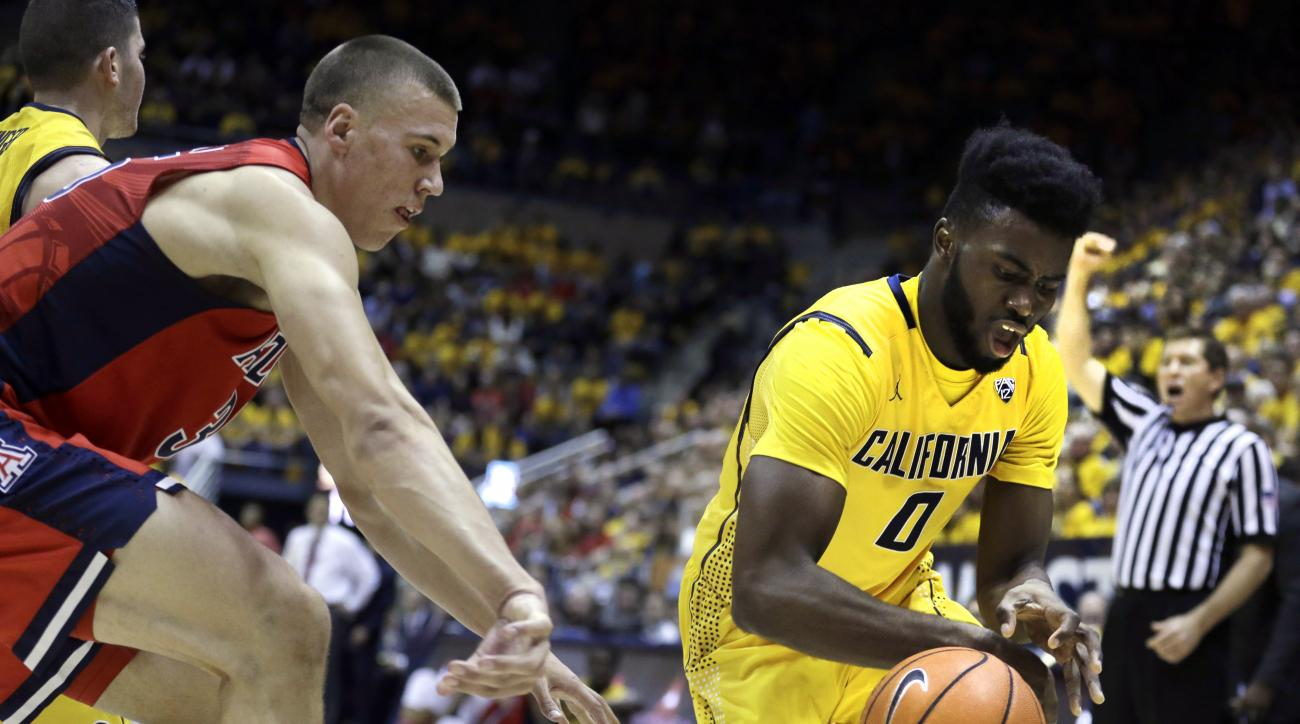 Arizona's Kaleb Tarczewski, left, and California's Jaylen Brown (0) chase a loose ball during the first half of an NCAA college basketball game Saturday, Jan. 23, 2016, in Berkeley, Calif. (AP Photo/Ben Margot)