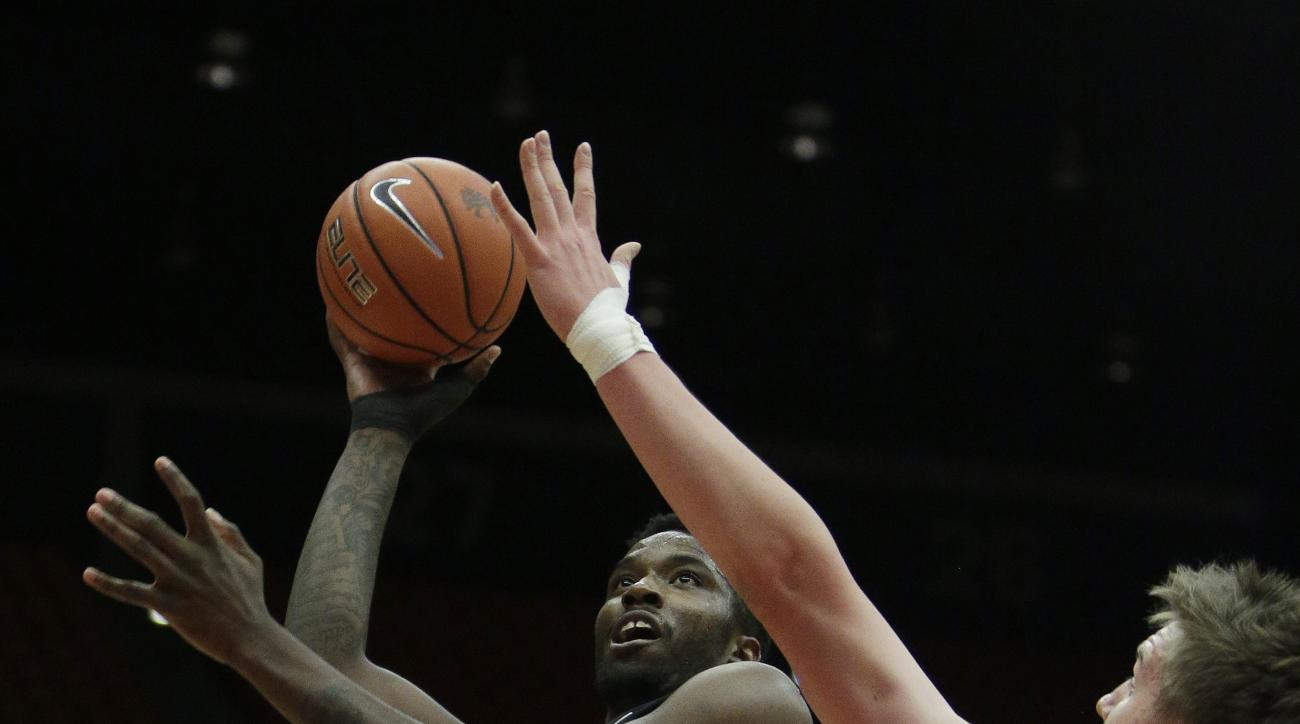 Colorado's Wesley Gordon (1) shoots against Washington State's Josh Hawkinson (24) during the first half of an NCAA college basketball game Saturday, Jan. 23, 2016, in Pullman, Wash. (AP Photo/Young Kwak)