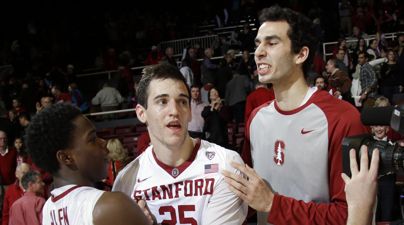 Stanford forward Rosco Allen, center, is hugged by teammates Marcus Allen (15) and Josh Sharma, right, after a 75-73 win over Arizona State in an NCAA college basketball game Saturday, Jan. 23, 2016, in Stanford, Calif. (AP Photo/Marcio Jose Sanchez)