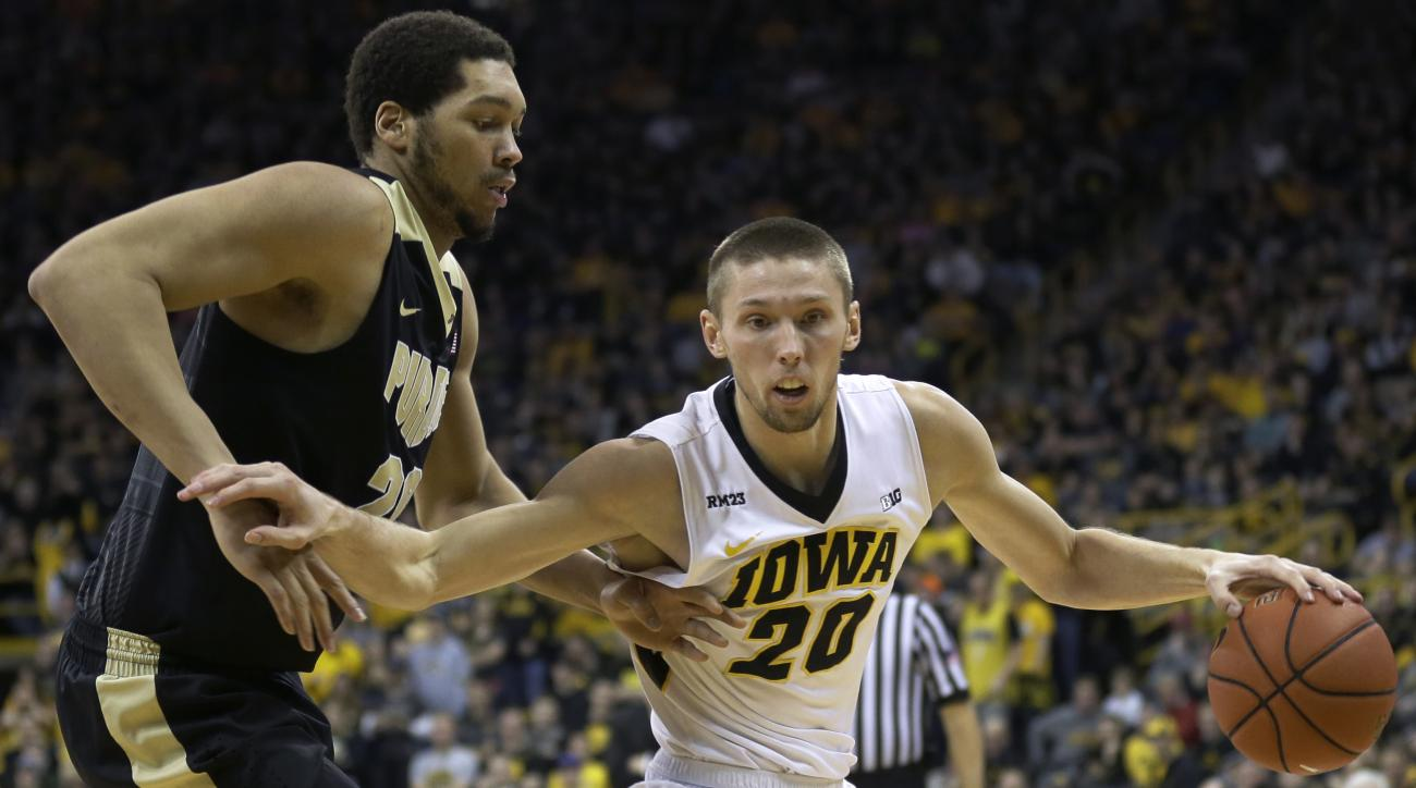 Iowa forward Jarrod Uthoff, right, drives past Purdue center A.J. Hammons during the second half of an NCAA college basketball game, Sunday, Jan. 24, 2016, in Iowa City, Iowa. Uthoff scored 22 points as Iowa won 83-71. (AP Photo/Charlie Neibergall)
