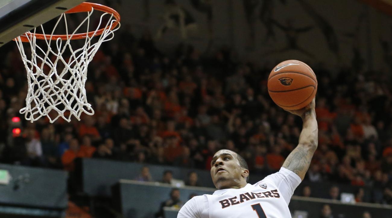 Oregon State's Gary Payton II goes for a dunk in the first half of an NCAA college basketball game against Southern California, in Corvallis, Ore., on Sunday, Jan. 24, 2016.  (AP Photo/Timothy J. Gonzalez)