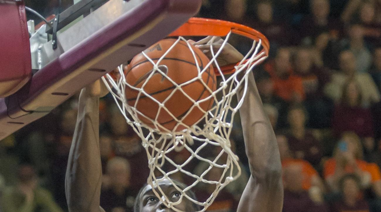 North Carolina forward Theo Pinson (1) dunks the ball against Virginia Tech during the first half of an NCAA college basketball game Sunday, Jan. 24, 2016, in Blacksburg, Va. (AP Photo/Don Petersen)