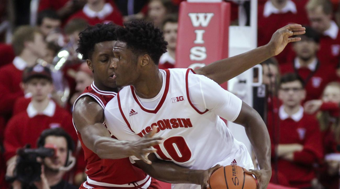 Indiana's OG Anunoby (3) reaches for the ball held by Wisconsin's Nigel Hayes (10) during the first half of an NCAA college basketball game Tuesday, Jan. 26, 2016, in Madison, Wis. (AP Photo/Andy Manis)