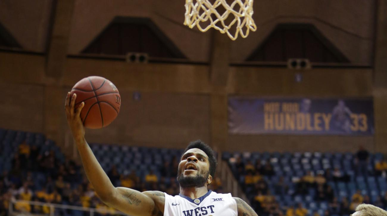 West Virginia guard Tarik Phillip (12) drives to the basket while being defended by Kansas State forward Austin Budke (35) during the second half of an NCAA college basketball game, Tuesday, Jan, 26, 2016, in Morgantown, W.Va. (AP Photo/Raymond Thompson)