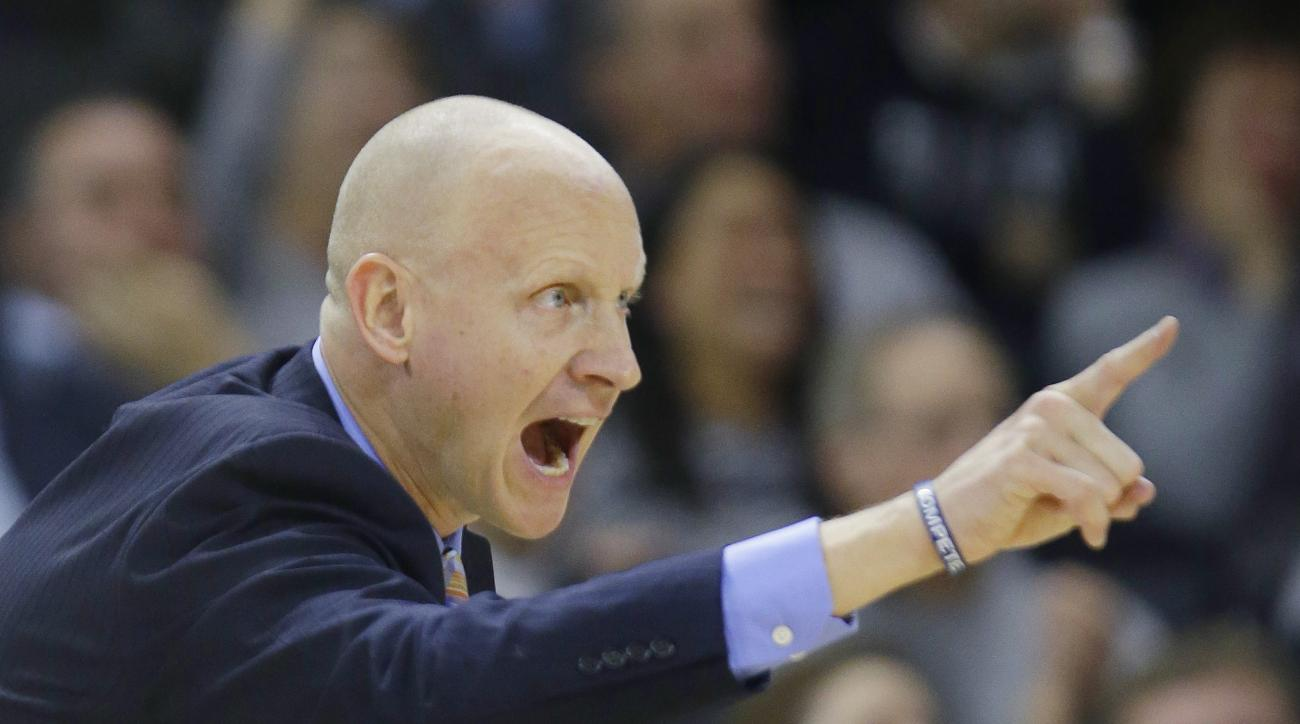 Xavier head coach Chris Mack shouts instructions to his team during the first half of an NCAA college basketball game against Providence, Tuesday, Jan. 26, 2016, in Providence, R.I. (AP Photo/Stephan Savoia)