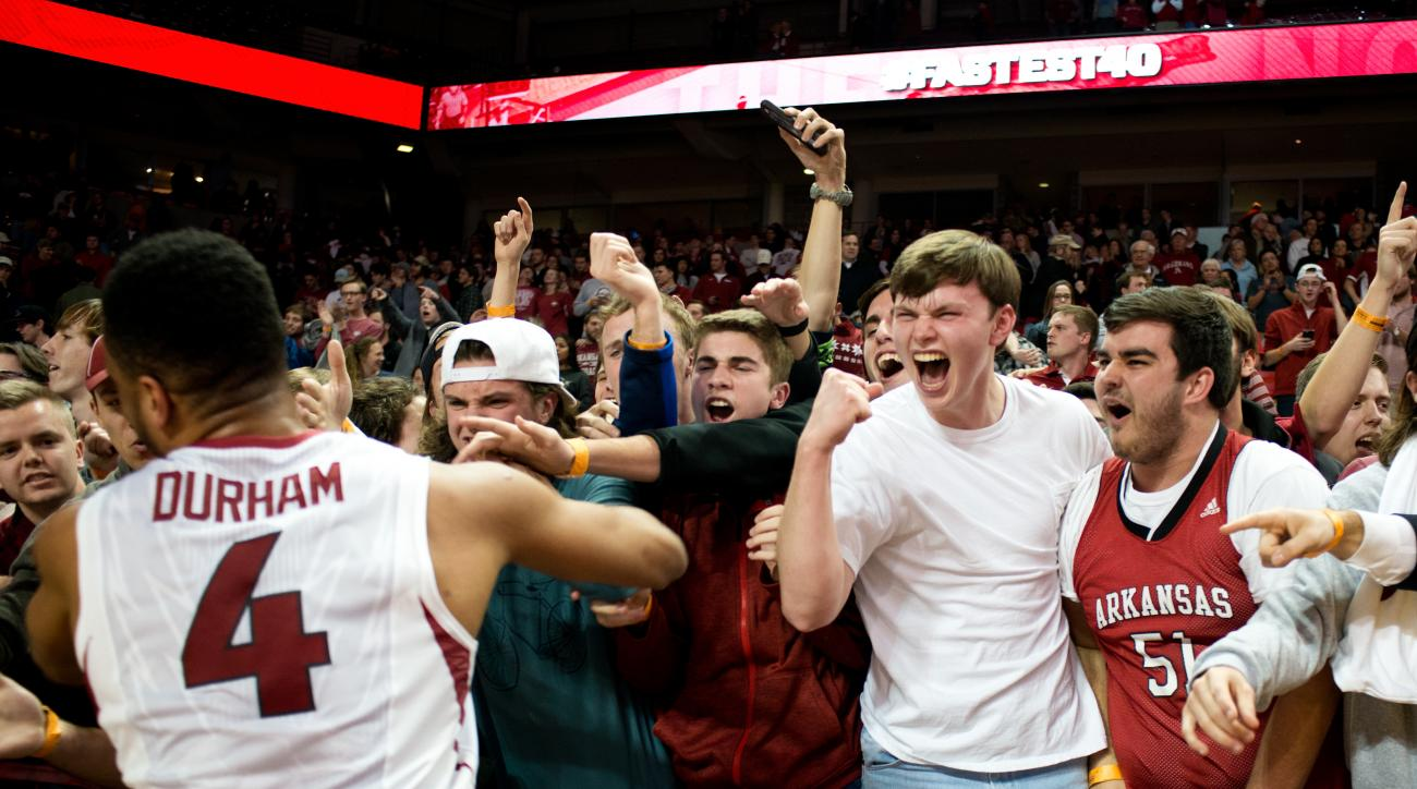 Arkansas fans celebrate following the upset win over Texas A&M in an NCAA college basketball game in Fayetteville, Ark., Wednesday, Jan. 27, 2016. Arkansas won 74-71. (AP Photo/Sarah Bentham)