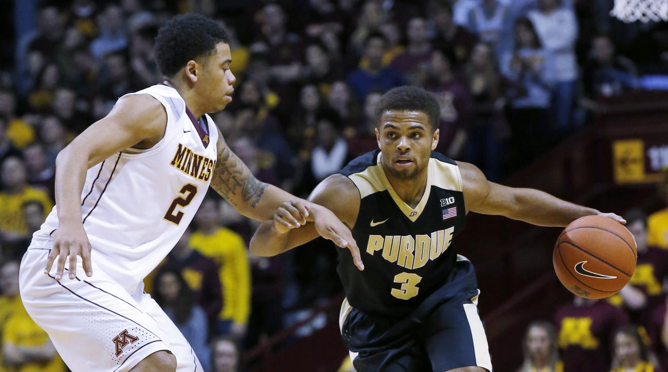 Purdue guard P.J. Thompson (3) drives against Minnesota guard Nate Mason (2) during the first half of an NCAA college basketball game in Minneapolis, Wednesday, Jan. 27, 2016. (AP Photo/Ann Heisenfelt)