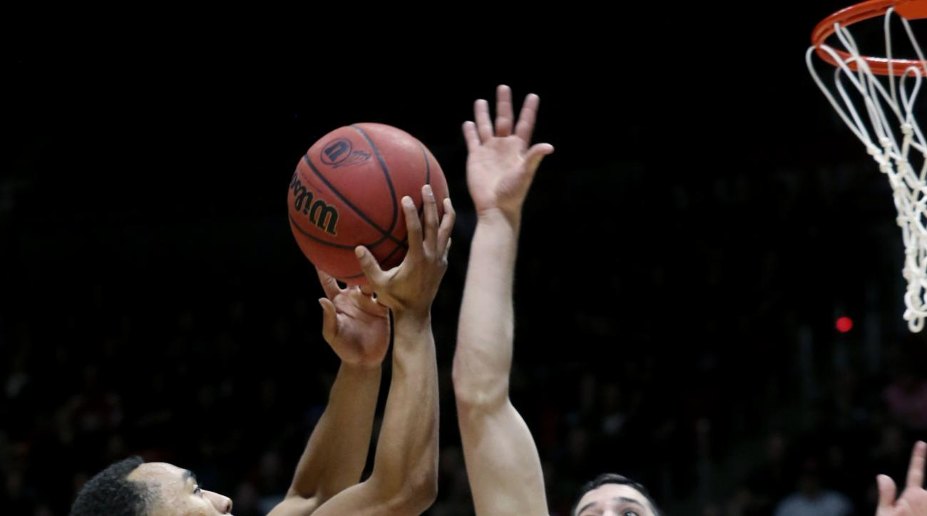 Utah guard Brandon Taylor (11) shoots as California guard Sam Singer (2) defends during the second half of an NCAA college basketball game Wednesday, Jan. 27, 2016, in Salt Lake City. (AP Photo/Kim Raff)