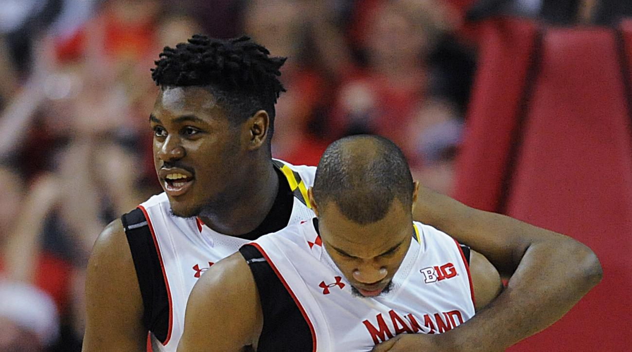 Maryland's Diamond Stone, left, hugs Rasheed Sulaimon after defeating Iowa 74-68 in an NCAA college basketball game, Thursday, Jan. 28, 2016, in College Park, Md. (AP Photo/Gail Burton)