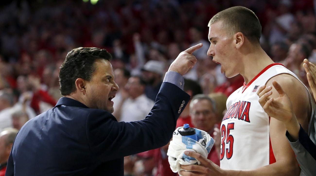Arizona coach Sean Miller, left, talks to Kaleb Tarczewski during the first half of an NCAA college basketball game against Oregon, Thursday, Jan. 28, 2016, in Tucson, Ariz. (AP Photo/Rick Scuteri)