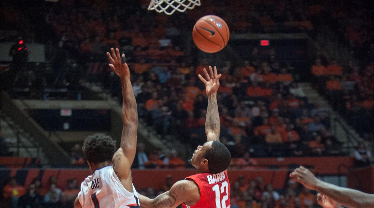 Ohio State guard A.J. Harris (12) puts up a shot over Illinois guard Jaylon Tate (1) in the second half of an NCAA College basketball game at the State Farm Center in Champaign, Ill., Thursday, Jan. 28, 2016. (AP Photo/Rick Danzl)