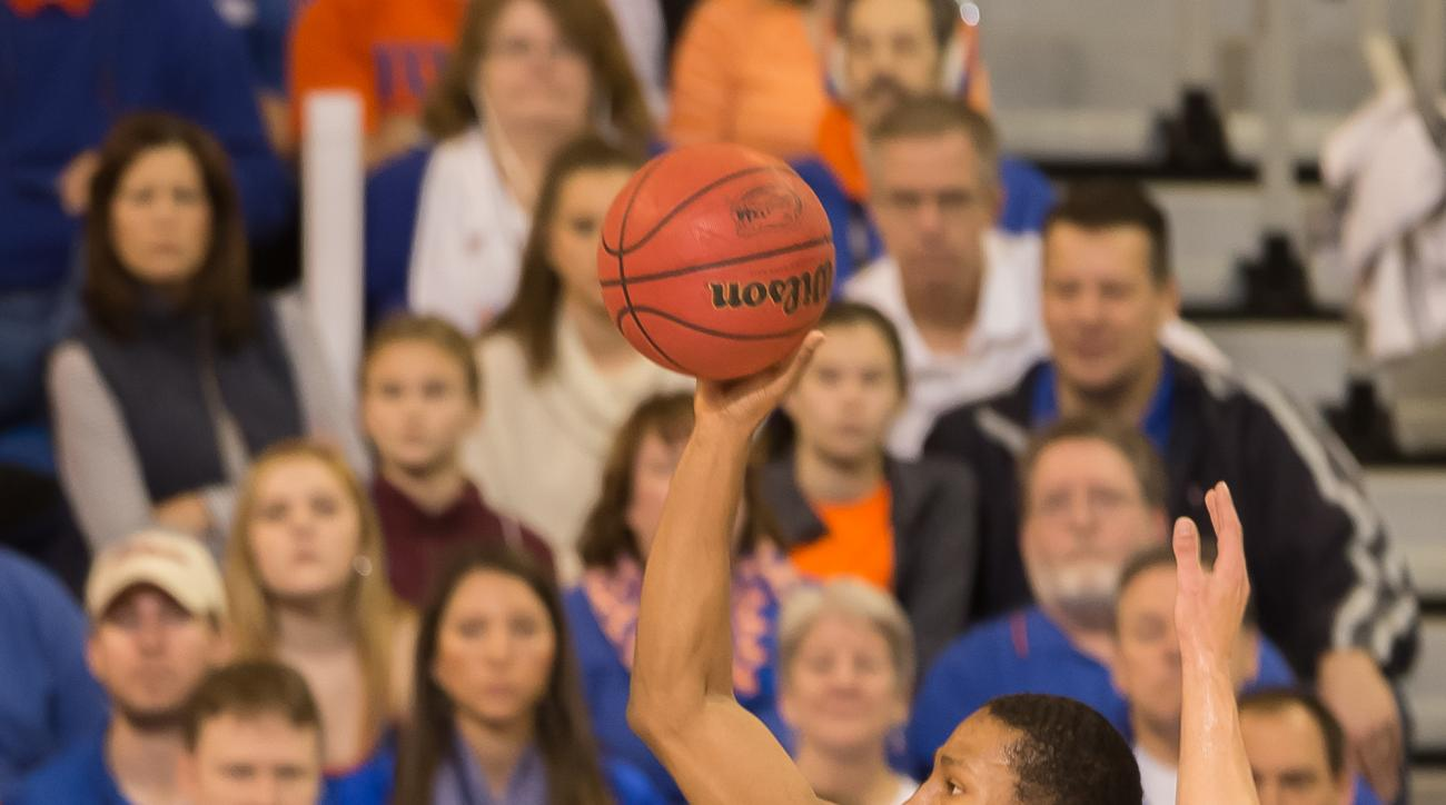 Florida guard KeVaughn Allen (4)  along the baseline during the first half of an NCAA college basketball game against West Virginia, Saturday, Jan. 30, 2016, in Gainesville, Fla. (AP Photo/Ronald Irby)