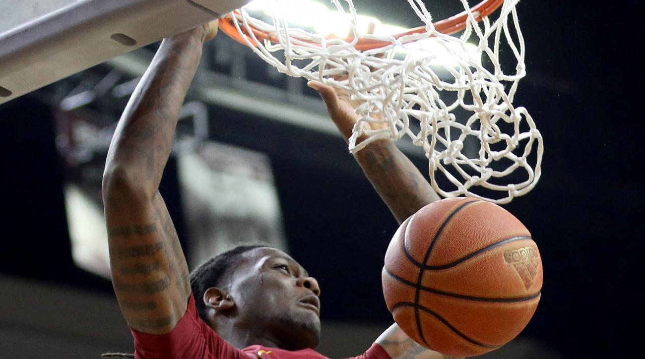 Iowa State's Jamell McKay (1) dunks against Texas A&M during the second half of an NCAA college basketball game, Saturday, Jan. 30, 2016, in College Station, Texas. (AP Photo/Sam Craft)