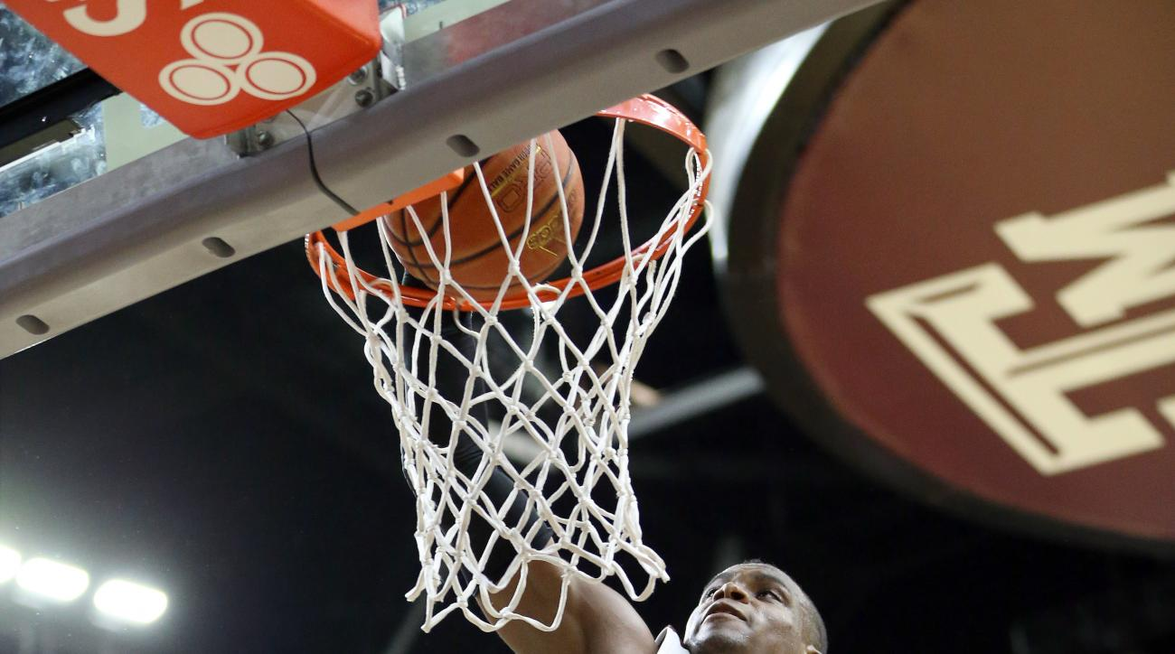 Texas A&M's Danuel House (23) dunks the ball against Iowa State during the second half of an NCAA college basketball game, Saturday, Jan. 30, 2016, in College Station, Texas. Texas A&M won 72-62. (AP Photo/Sam Craft)