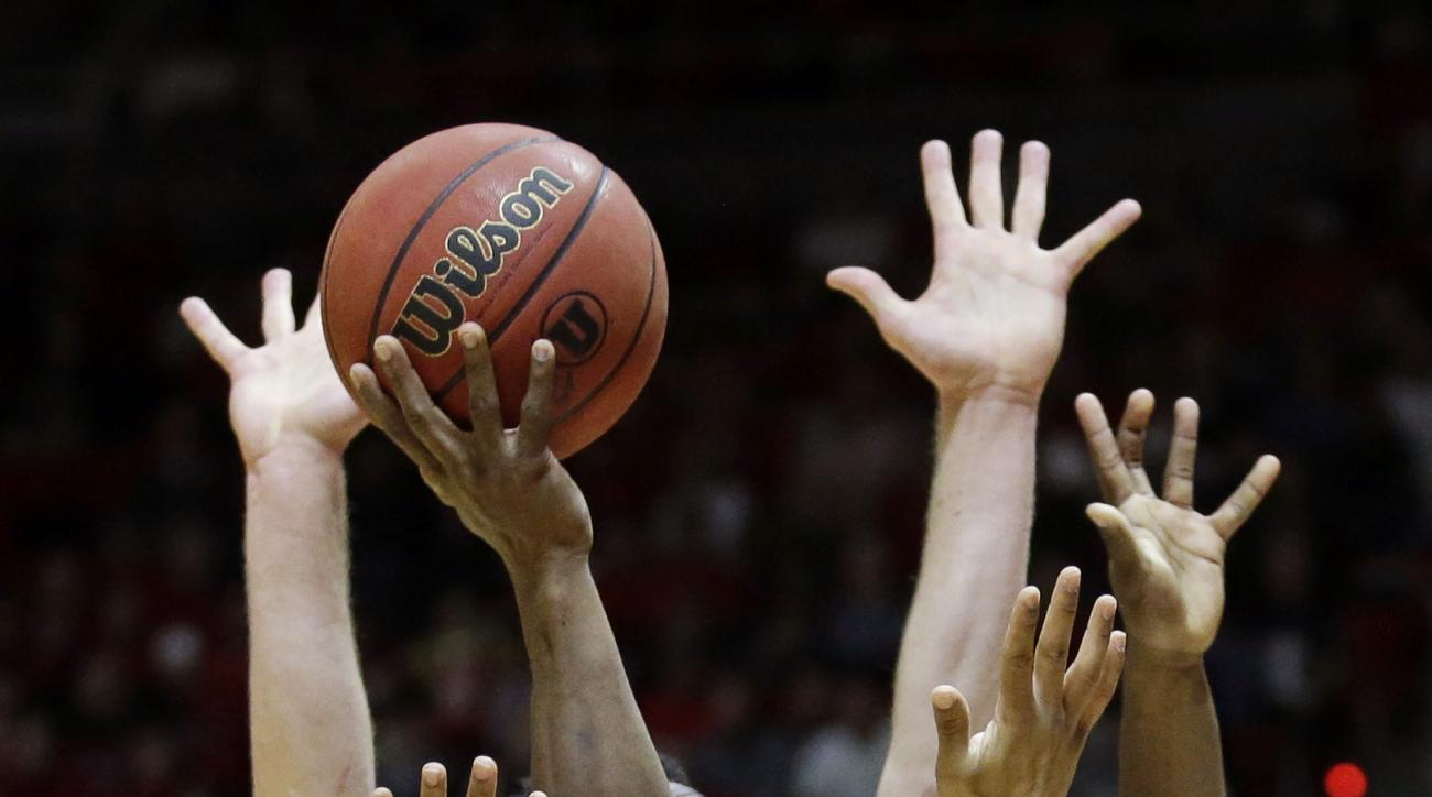Stanford guard Marcus Allen (15) goes to the basket as Utah guard Brandon Taylor (11) defends during the first half in an NCAA college basketball game Saturday, Jan. 30, 2016, in Salt Lake City.  (AP Photo/Rick Bowmer)