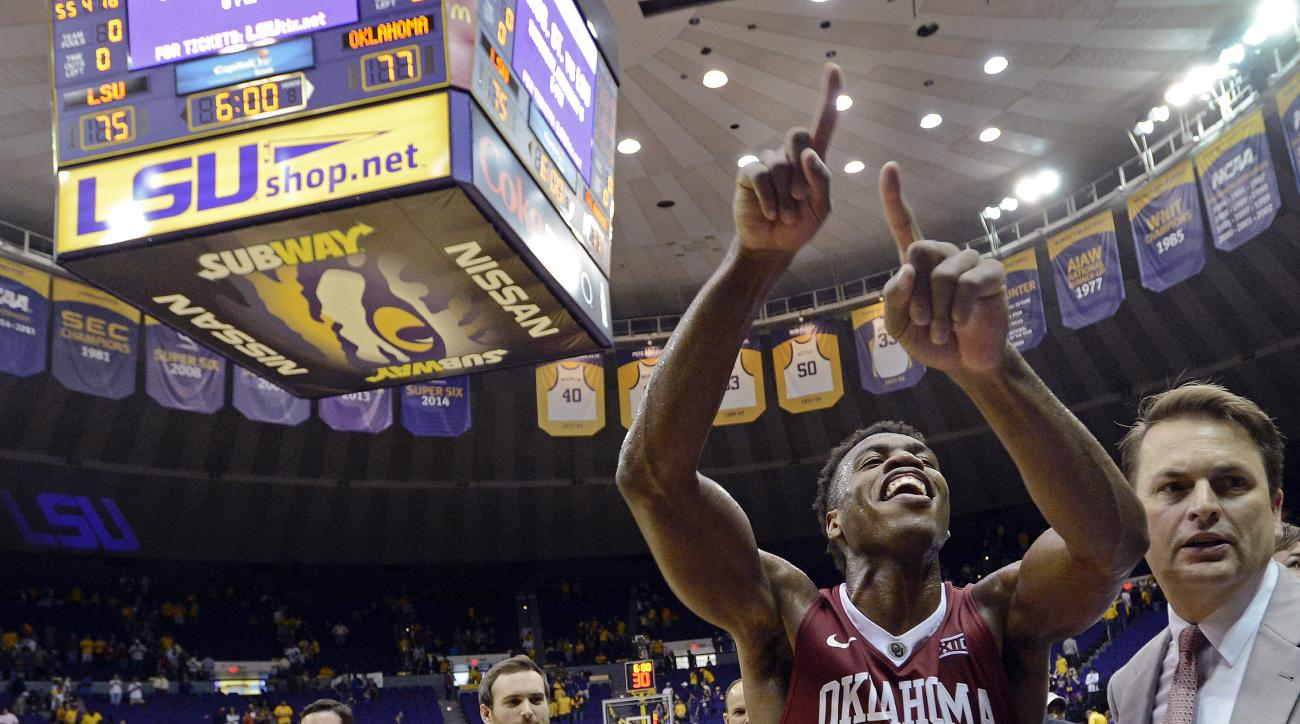 Oklahoma guard Buddy Hield (24) celebrates the team's 77-75 win over LSU in an NCAA college basketball game in Baton Rouge, La., Saturday, Jan. 30, 2016. (AP Photo/Bill Feig)