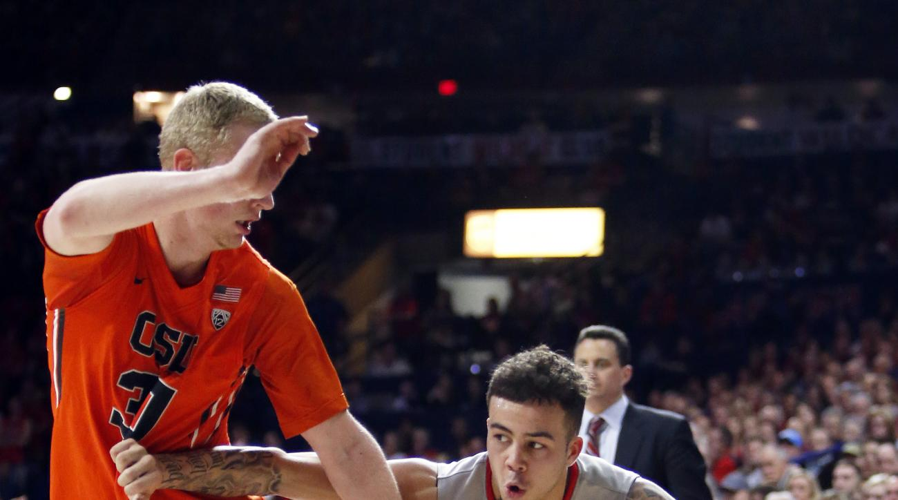 Arizona guard Gabe York (1) drives on Oregon State forward Olaf Schaftenaar during the second half of an NCAA college basketball game Saturday, Jan. 30, 2016, in Tucson, Ariz. Arizona defeated Oregon State 80-63. (AP Photo/Rick Scuteri)