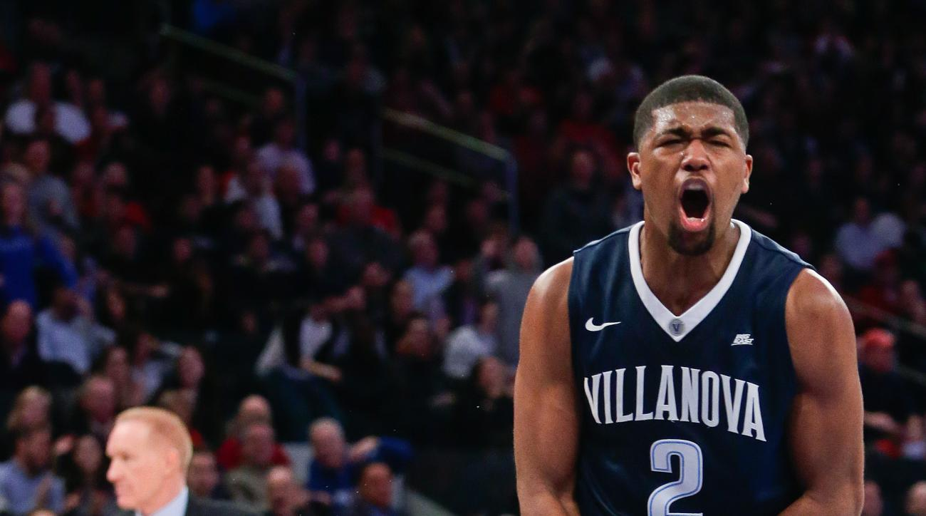 Villanova's Kris Jenkins (2) celebrates as St. John's head coach Chris Mullin, left, reacts during the first half of an NCAA college basketball game Sunday, Jan. 31, 2016, in New York. (AP Photo/Frank Franklin II)
