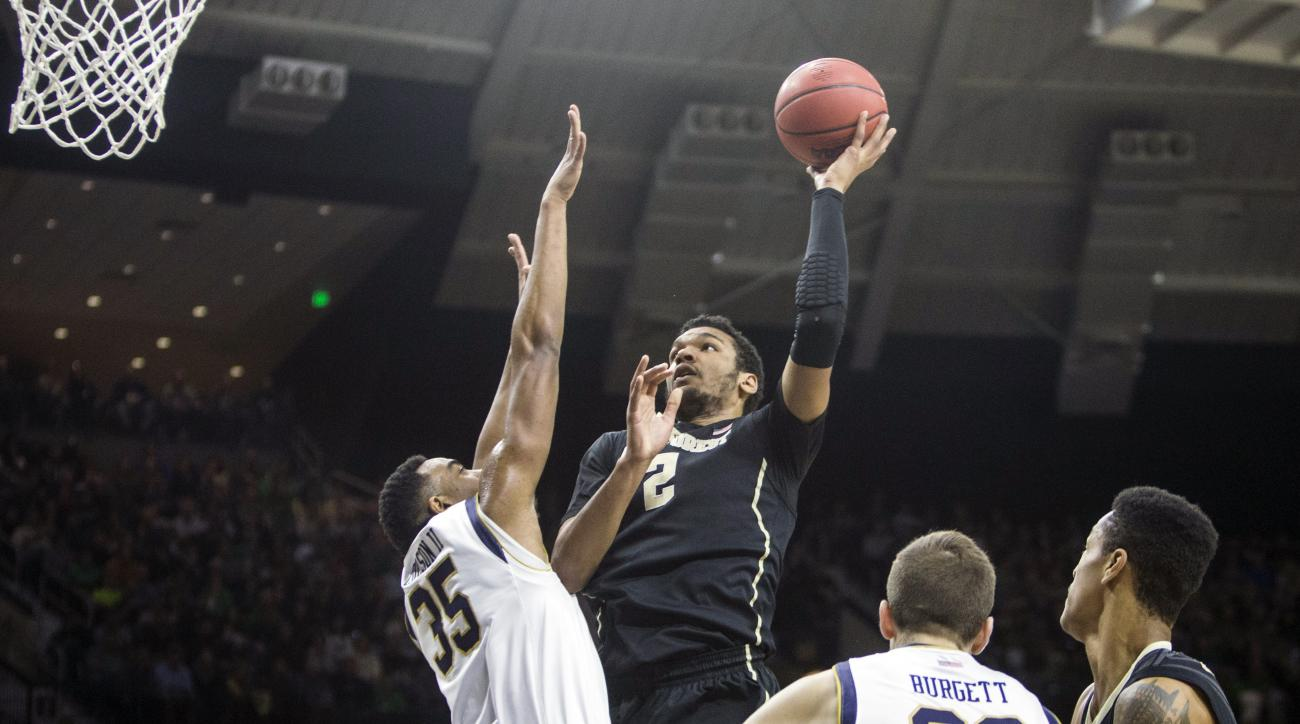 Wake Forest's Devin Thomas (2) shoots over Notre Dame's Bonzie Colson (35) during the first half of an NCAA college basketball game Sunday, Jan. 31, 2016, in South Bend, Ind. (AP Photo/Robert Franklin)