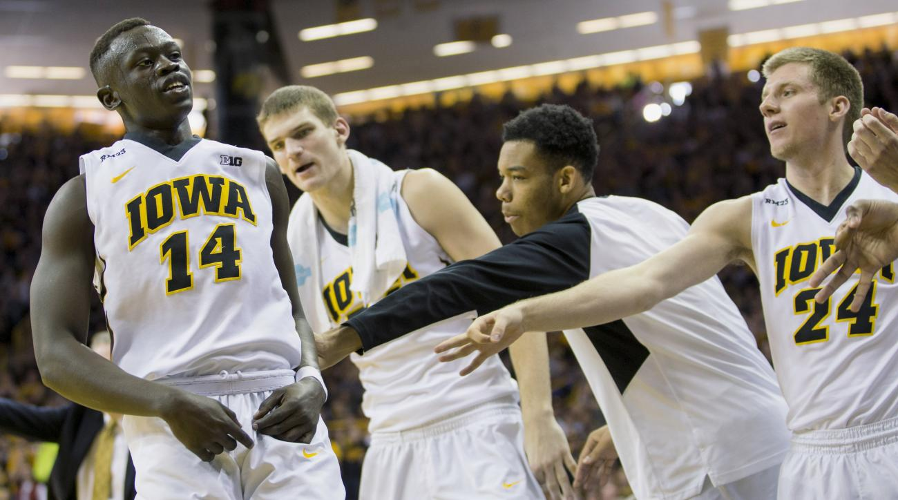 Iowa guard Peter Jok is cheered by the bench after hitting a three pointer during the second half of an NCAA college basketball game against Northwestern, Sunday, January 31, 2016, in Iowa City, Iowa. Iowa won 85-71. (AP Photo/Justin Hayworth)