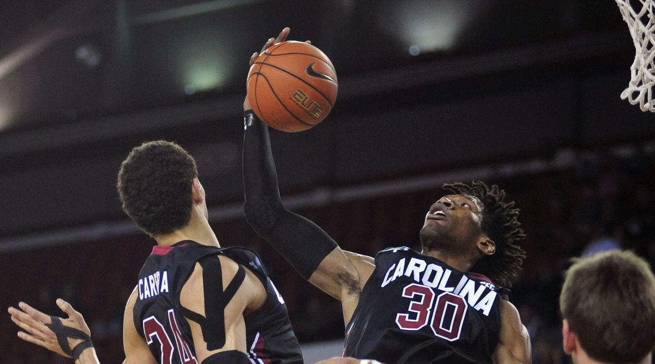 South Carolina forward Chris Silva (30) grabs a rebound during an NCAA college basketball game against Georgia,Tuesday, Feb. 2, 2016, in Athens, Ga. (AP Photo/Richard Hamm)