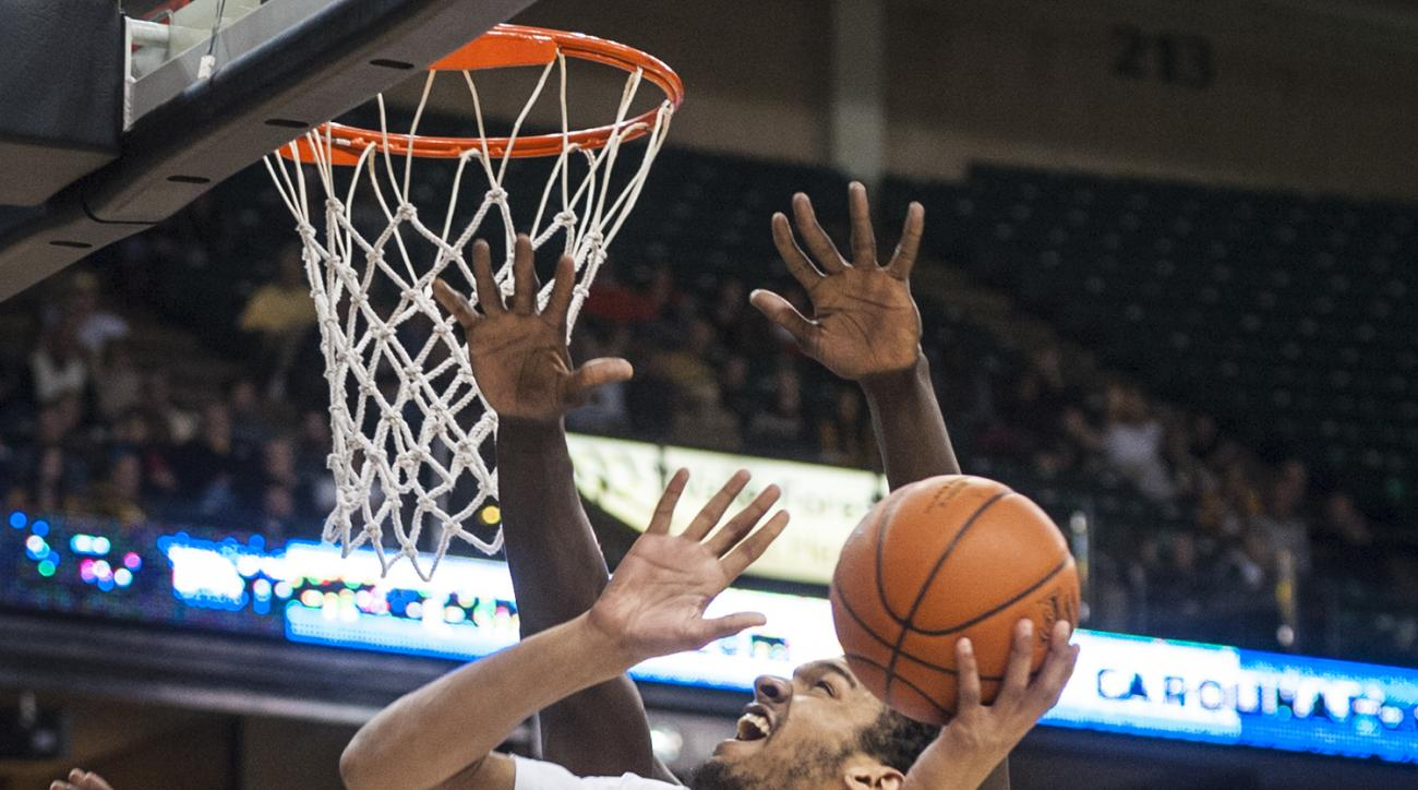 Wake Forest forward Devin Thomas (2) shoots as Clemson center Sidy Djitte (50), partially obscured, defends during an NCAA college basketball game Tuesday, Feb. 2, 2016, in Winston-Salem, N.C. (Andrew Dye/Winston-Salem Journal via AP()