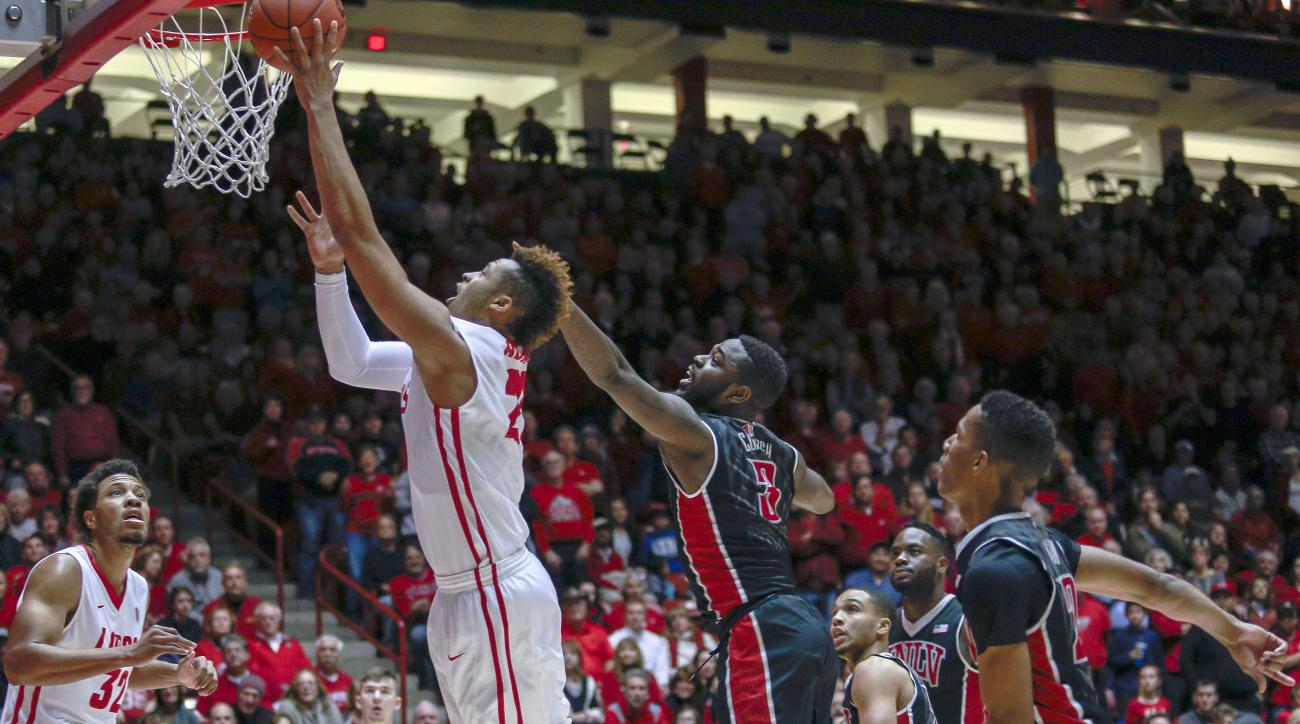 New Mexico's Xavier Adams (21) shoots while guarded by UNLV's Jordan Cornish (3) during the first half of an NCAA college basketball game, Tuesday, Feb. 2, 2016, in Albuquerque, N.M. (AP Photo/Juan Labreche)