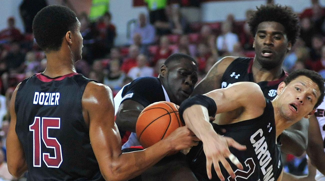 Georgia forward Derek Ogbeide (34) competes with South Carolina forward Michael Carrera (24) and South Carolina guard PJ Dozier (15) for a loose ball during an NCAA college basketball game Tuesday, Feb. 2, 2016, in Athens, Ga. (AP Photo/Richard Hamm)