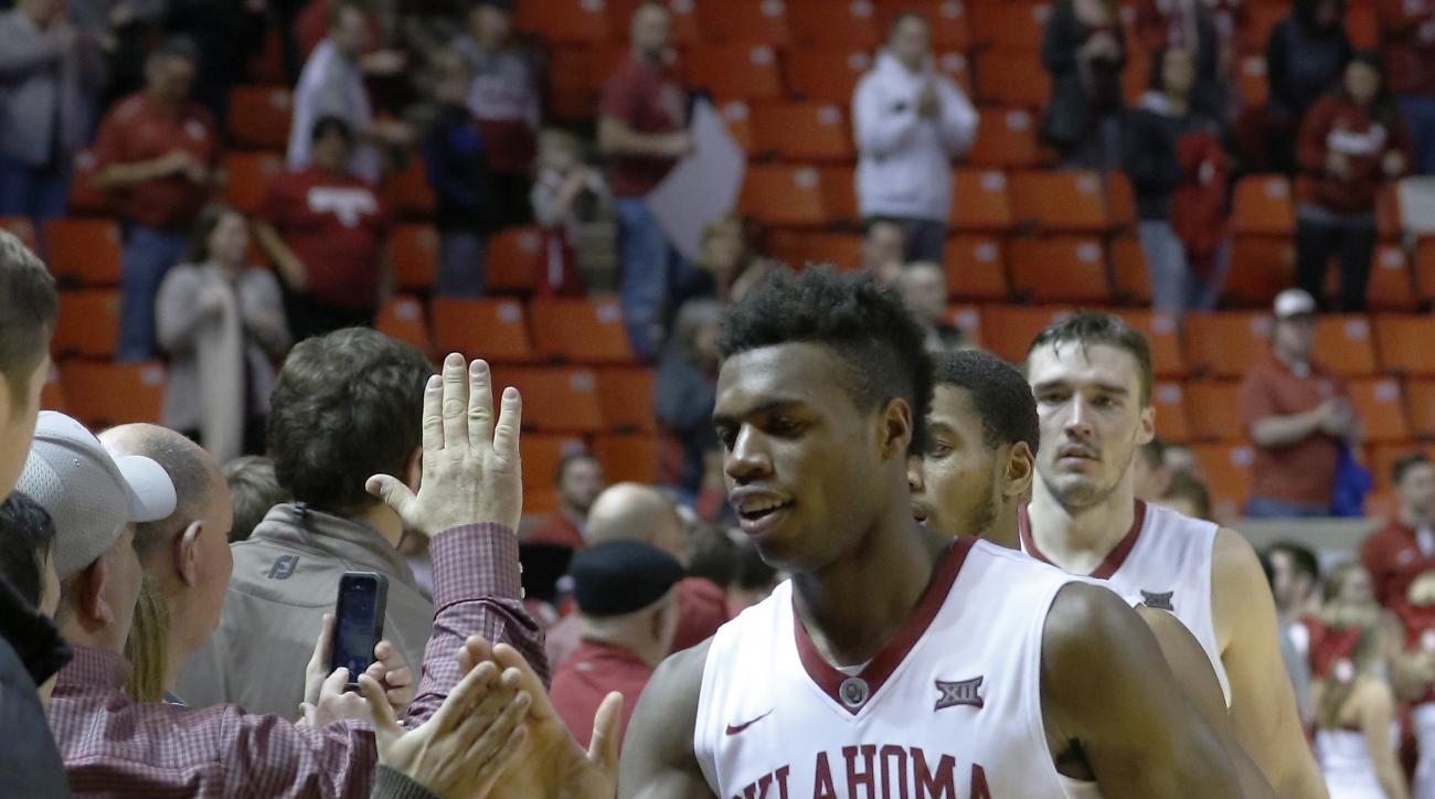 Oklahoma guard Buddy Hield (24) high fives fans after Oklahoma defeated TCU during an NCAA college basketball game in Norman, Okla., Tuesday, Feb. 2, 2016. Oklahoma won 95-72. (AP Photo/Alonzo Adams)
