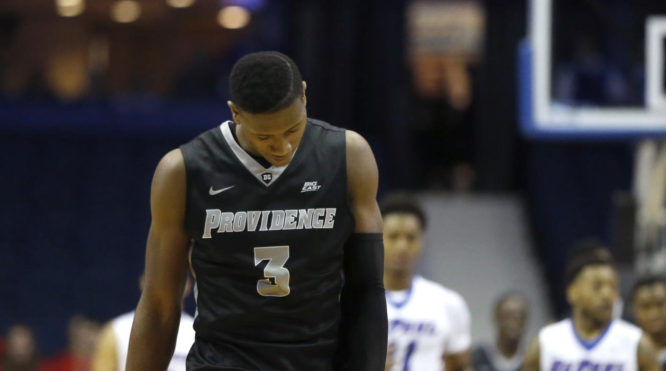Providence guard Kris Dunn (3) walks to the other end of the court after missing a 3-point shot in the closing seconds of the team's NCAA college basketball game against DePaul on Tuesday, Feb. 2, 2016, in Rosemont, Ill. DePaul won 77-70. (AP Photo/Charle