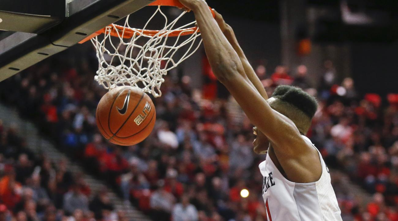 San Diego State forward Malik Pope dunks against Colorado State during the first half of an NCAA college basketball game Tuesday, Feb. 2, 2016, in San Diego.  (AP Photo/Lenny Ignelzi)