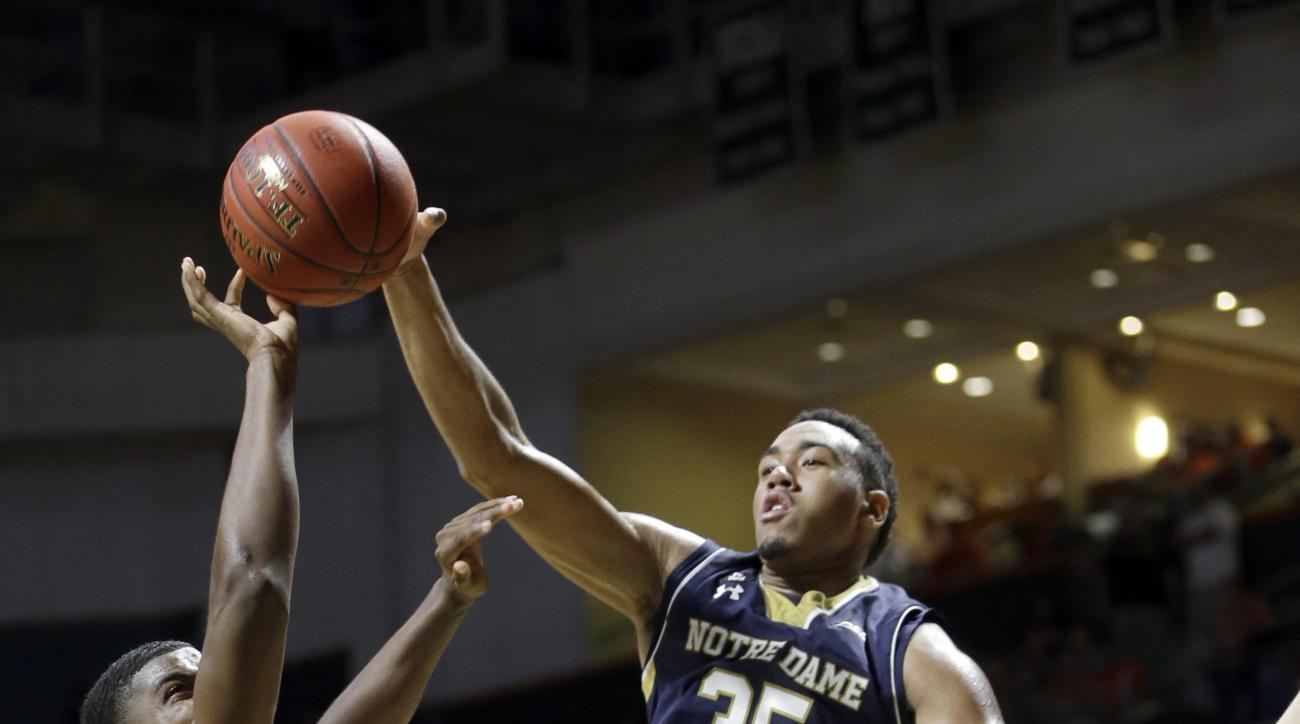 Miami forward Anthony Lawrence Jr. (3) shoots against Notre Dame forward Bonzie Colson (35) and Rex Pflueger (0) in the first half of an NCAA college basketball game, Wednesday, Feb. 3, 2016, Coral Gables, Fla. (AP Photo/Alan Diaz)