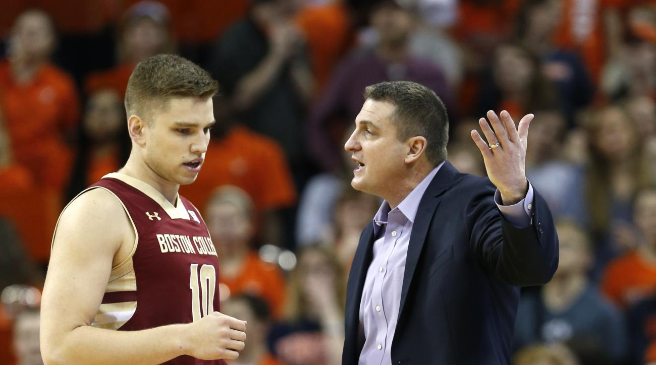 Boston College coach Jim Christian talks with forward Ervins Meznieks during the first half of the team's NCAA college basketball game against Virginia in Charlottesville, Va., Wednesday, Feb. 3, 2016. (AP Photo/Steve Helber)