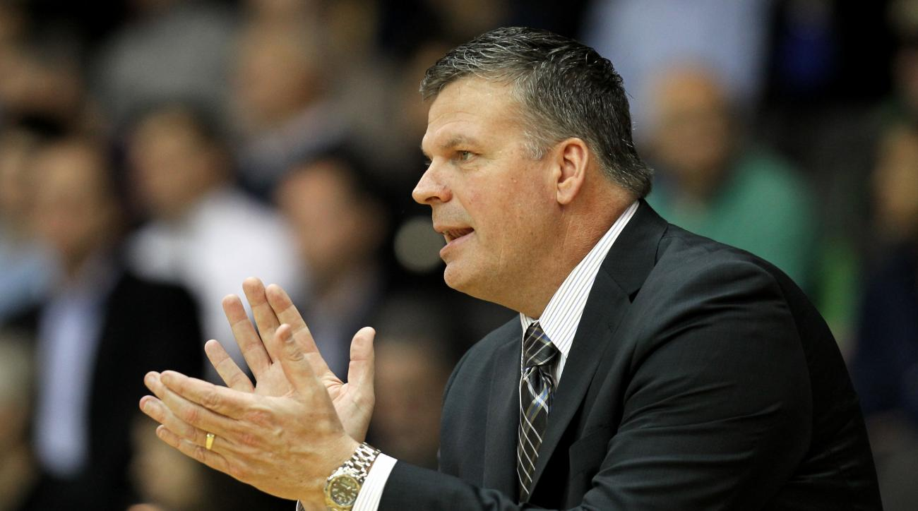 Creighton head coach Greg McDermott shouts from the bench in the first half of an NCAA college basketball game against Villanova, Wednesday, Feb. 3, 2016, in Villanova, Pa. (AP Photo/Laurence Kesterson)