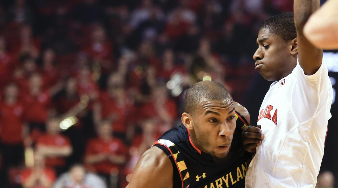 Maryland's Rasheed Sulaimon (0) drives around Nebraska's Glynn Watson Jr. (5) during the first half of an NCAA college basketball game in Lincoln, Neb., Wednesday, Feb. 3, 2016. (AP Photo/Nati Harnik)