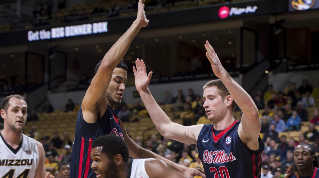 Missouri's Kevin Puryear, center, looks for help as he is guarded by Mississippi's Jake Coddington, right, and Anthony Perez during the first half of an NCAA college basketball game Wednesday, Feb. 3, 2016, in Columbia, Mo. (AP Photo/L.G. Patterson)