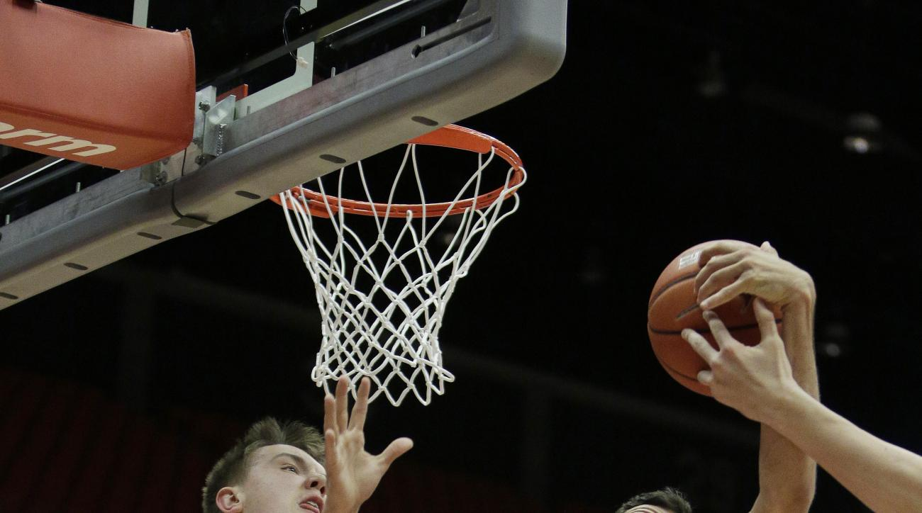 Washington State's Josh Hawkinson (24) and Arizona's Mark Tollefsen (23) go after a rebound during the first half of an NCAA college basketball game, Wednesday, Feb. 3, 2016, in Pullman, Wash. (AP Photo/Young Kwak)
